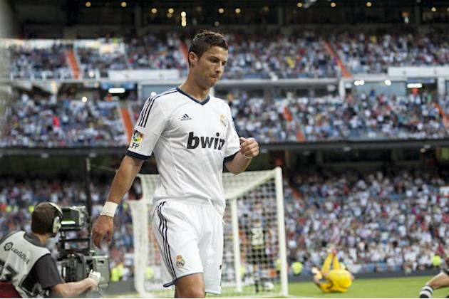 Real Madrid's Portuguese forward Cristiano Ronaldo celebrates his first goal on September 2, 2012 during a Spanish Liga football match against Granada at the Santiago Bernabeu stadium in Madrid. AFP P