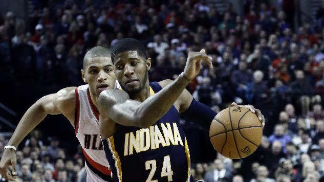Indiana Pacers forward Paul George, right, drives to the basket past Portland Trail Blazers forward Nicolas Batum, from France, during the second half of an NBA basketball game in Portland, Ore., Monday, Dec. 2, 2013.  George scored a career-high 43 points as the Trail Blazers won 106-102