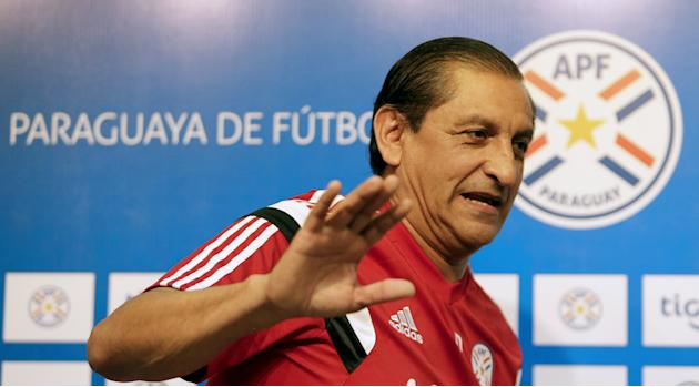 Paraguay's national soccer coach Diaz gestures after a news conference in Asuncion