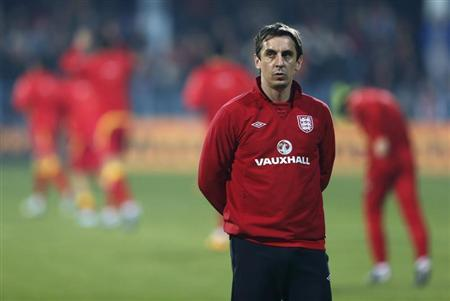 England assistant coach Neville walks on the pitch before their World Cup qualifying soccer match against Montenegro in Podgorica