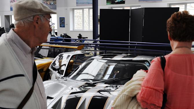 Visitors look at classic Ford GT 40 raci