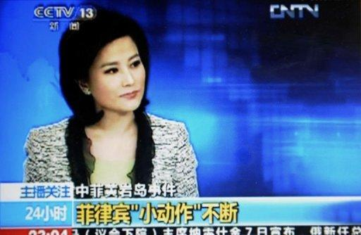 He Jia, an anchor for China Central Television's news broadcast, claims the Philippines as part of China