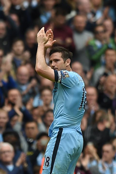 Manchester City midfielder Frank Lampard applauds as he leaves the pitch after being substituted during the Premier League match against Southampton at Etihad Stadium on May 24, 2015