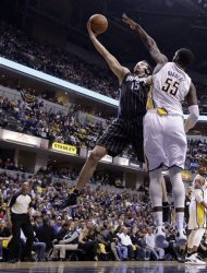 Orlando Magic forward Hedo Turkoglu (15) shoots past Indiana Pacers center Roy Hibbert in the first half of an NBA first-round playoff basketball game in Indianapolis, Saturday, April 28, 2012. (AP Photo/Michael Conroy)