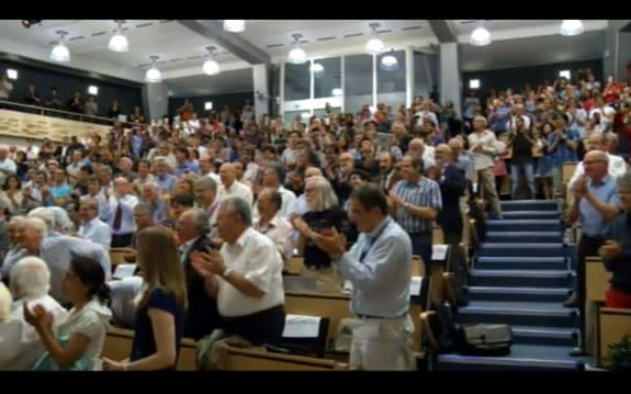 Physicists at the CERN lab in Switzerland applaud news of the discovery of a new particle, likely the Higgs boson, July 4, 2012.