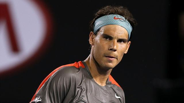 Australian Open - Nadal advances after injured Tomic retires