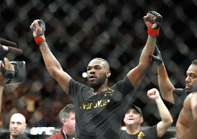 FILE - This Jan. 3, 2015, file photo shows Jon Jones celebrates after defeating Daniel Cormier during their light heavyweight title mixed martial arts bout in Las Vegas. Albuquerque police were search
