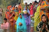 Indian Hindu devotees pay homage during Chhat Puja while standing in the sarover of the Durgiana temple in Amritsar. The festival of Chhath is celebrated across India and the number of devotees was likely to swell at dawn on Tuesday when many more worshippers are expected to throng rivers to offer prayers to the rising sun