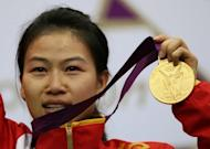 China's world number one Yi Siling won the first gold of the London Olympics in the women's 10m air rifle competition at London's Royal Artillery Barracks on Saturday. In a tense contest Poland's Sylwia Bogacka took silver while Yu Dan of China won bronze. Yi, who won the title in the event at the 2010 world championships in Munich, had a total winning score of 502.9, 0.7 points ahead of Bogacka