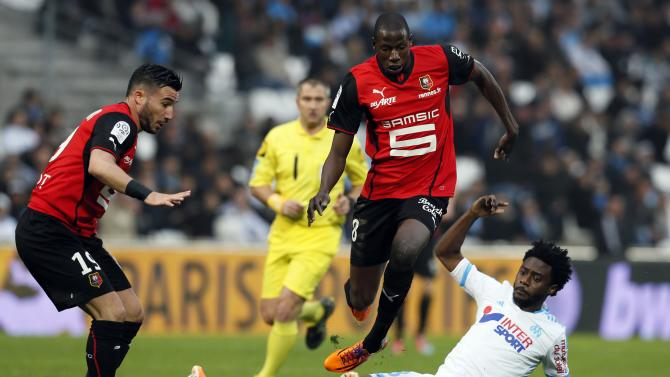 Doucoube of Rennes jumps over Olympique Marseille Nkoulou during their French Ligue 1 soccer match at the Velodrome stadium in Marseille