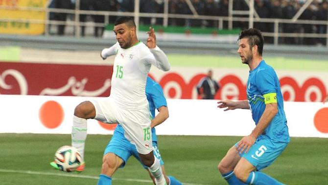 In this photo dated Wednesday, March 5, 2014, Algerian player, Soudani Hilal el Arabi, controls the ball while Bostjan Cesar of Slovenia, right, looks on during their international friendly soccer match at Blida stadium, near the Algerian capital Algiers. Algeria defeated Slovenia 2-0