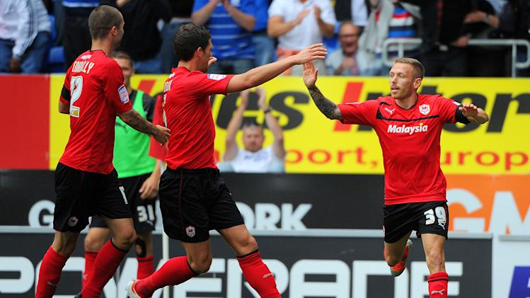 Cardiff's Craig Bellamy, right, celebrates scoring against Leeds on Saturday