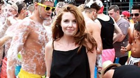 Presenter Stacey Dooley enjoys the company of some people covered in foam.