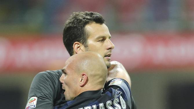 Inter Milan Argentine midfielder Esteban Cambiasso, right, celebrates with his teammate goalkeeper Samir Handanovic, of Slovenia, after winning the Serie A soccer match between Inter Milan and Fiorentina at the San Siro stadium in Milan, Italy, Thursday, Sept. 26, 2013