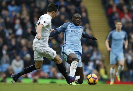 Manchester City's Yaya Toure in action with Swansea City's Jack Cork