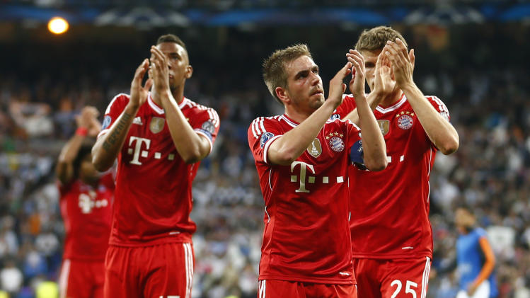 Bayern's Jerome Boateng, Philipp Lahm and Thomas Mueller, from left, acknowledge the fans after losing 0-1 in a  Champions League semifinal first leg soccer match between Real Madrid and Bayern Munich at the Santiago Bernabeu stadium in Madrid, Spain, Wednesday, April 23, 2014