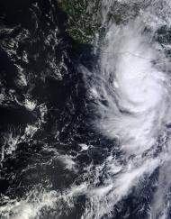 NASA's Terra satellite flew over Raymond on Oct. 20, 2013, at 2 p.m. EDT and saw clouds associated with Raymond's northern quadrant were streaming over mainland Mexico, despite the center being over open water.