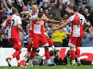 This file photo shows Queens Park Rangers' players celebrating a goal during an English Premier League match in May. QPR will visit Malaysia and Indonesia next month in their first pre-season Asia tour, sponsor AirAsia has announced