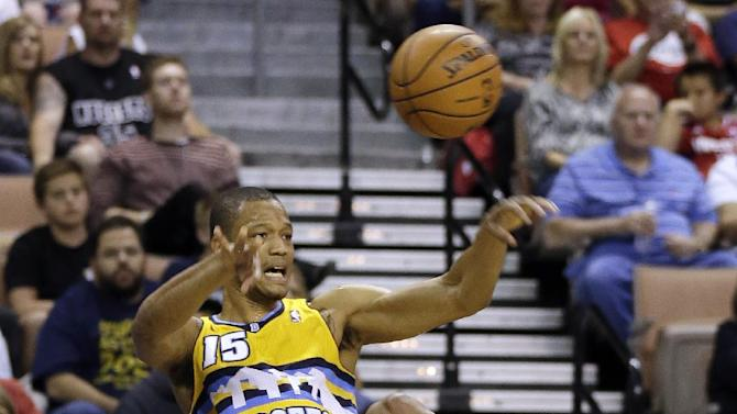 The Denver Nuggets Anthony Randolph inbounds the ball during the first half of a preseason NBA basketball game against the Los Angeles Clippers on Saturday, Oct. 19, 2013, in Las Vegas