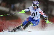 Slovenia's Tina Maze slaloms past a pole during the first run of an alpine ski, women's World Cup slalom, in Lienz, Austria, Thursday, Dec. 29, 2011. Maze set the second fastest time. (AP Photo/Giovanni Auletta)