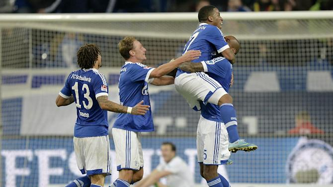 Schalke's Jefferson Farfan jumps on teammate Felipe Santana after scoring during the German   Bundesliga soccer match between FC Schalke 04 and Werder Bremen in Gelsenkirchen, Germany, Saturday, Nov. 9, 2013