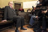 Count Alfons Mensdorff-Pouilly (left) gets some media interest as he waits at the courtroom for his trial on December 12, 2012 in Vienna. The colourful Austrian count was cleared on Thursday of laundering millions of euros (dollars) on behalf of British defence giant BAE Systems to win arms contracts in central and eastern Europe