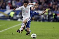 Japan's Yasuyuki Konno (L) clashes with France's Mathieu Debuchy during their friendly match at the Stade de France in Saint-Denis, near Paris. Japan won 1-0