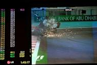 A giant screen shows Nico Rosberg (above) crashing his Mercedes into Narain Karthikeyan's Hispania during the Abu Dhabi Grand Prix. Rosberg was fortunate to walk away unscathed after the massive crash