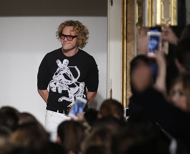 Norwegian fashion designer Peter Dundas acknowledges the applause of the audience after presenting the Emilio Pucci women's Fall-Winter 2015-16 collection, part of Milan Fashion Week, unveiled in