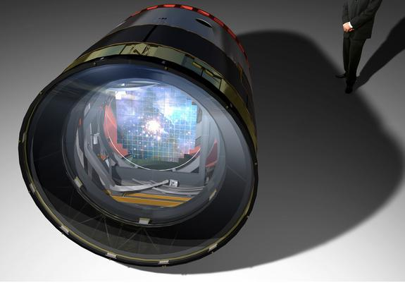 An artist's rendering of the Large Synoptic Survey Telescope's camera, with a man standing behind it to show its size.