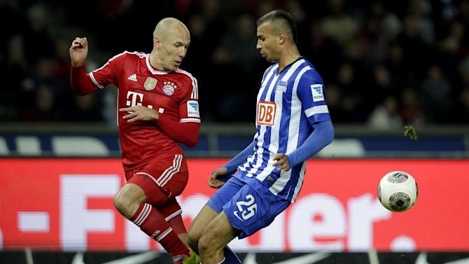 Berlin's John Anthony Brooks of the U.S., right, and Bayern's Arjen Robben of the Netherlands challenge for the ball during  the German Bundesliga soccer match between Hertha BSC Berlin and Bayern Munich in Berlin, Germany, Tuesday, March 25, 2014