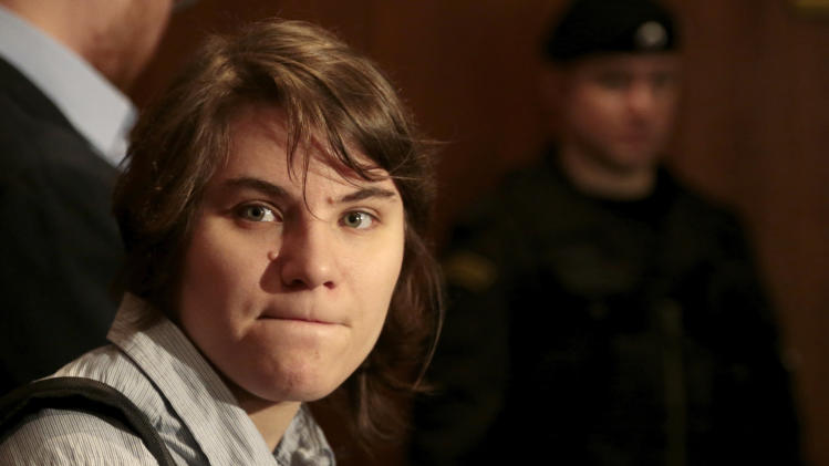 Member of the Pussy Riot punk band Yekaterina Samutsevich waits before entering a court room, in Moscow, Russia, Wednesday, Jan. 30, 2013. Samutsevich's efforts to repeal a decision banning the group's videos in Russia was rejected by the court. (AP Photo/Ivan Sekretarev)