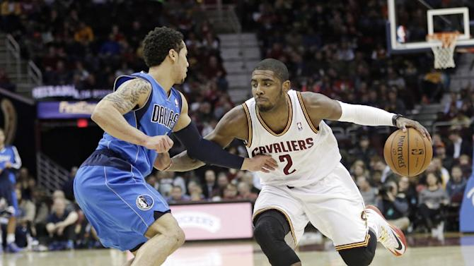 Cleveland Cavaliers' Kyrie Irving (2) drives past Dallas Mavericks' Shane Larkin (3) during the second quarter of an NBA basketball game Monday, Jan. 20, 2014, in Cleveland