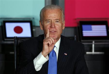 U.S. Vice President Joe Biden (L) gestures as he speaks to Japanese business leaders during their meeting at the headquarters of internet commerce and mobile games provider DeNA Co. in Tokyo December 3, 2013. REUTERS/Toru Hanai