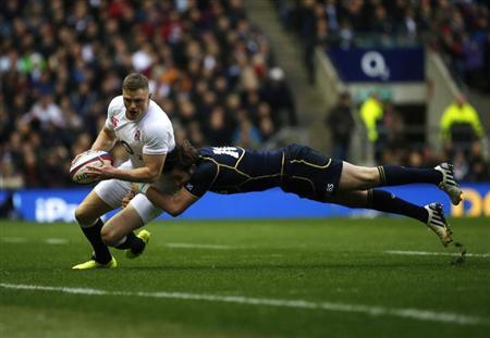 England's Ashton is tackled by Scotland's Visser during their Six Nations international rugby union match at the Twickenham Stadium in London