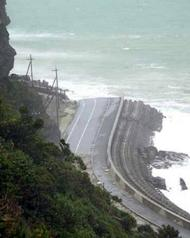 A road is washed out by tidal wave caused by Typhoon Tokage at Keruma island in Okinawa prefecture in 2004. Typhoon Bolaven may cause 13 metre waves along the Okinawa coast all day on Monday, the Japan Meteorological Agency says