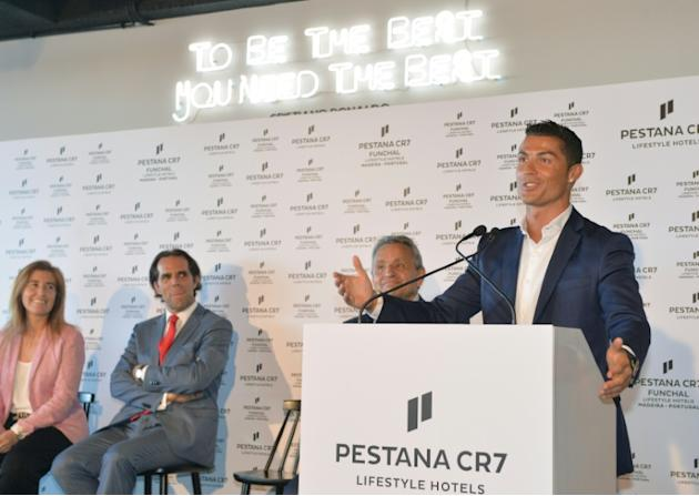 Portuguese forward Cristiano Ronaldo (R) speaks during the opening of Pestana CR7 Hotel in Funchal, on Madeira island on July 22, 2016