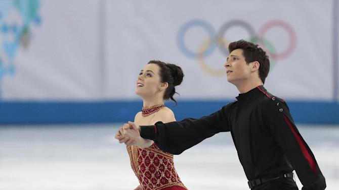 Tessa Virtue and Scott Moir of Canada compete in the team free ice dance figure skating competition at the Iceberg Skating Palace during the 2014 Winter Olympics, Sunday, Feb. 9, 2014, in Sochi, Russia
