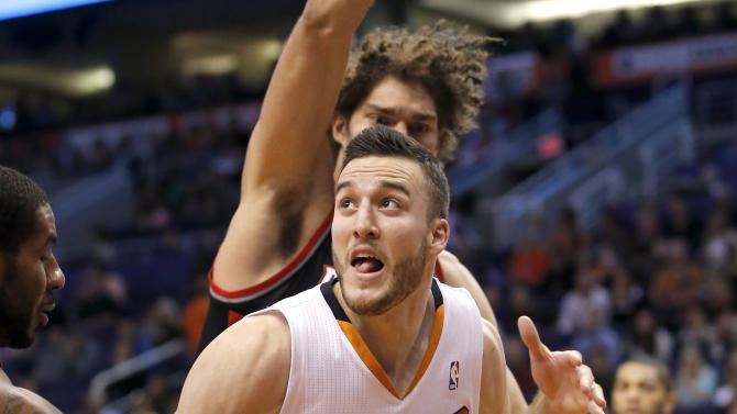 Phoenix Suns' Miles Plumlee looks to shoot against the Portland Trail Blazers during the second half of an NBA basketball game, Wednesday, Nov. 27, 2013, in Phoenix