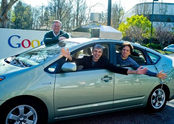 Google Executive Chairman Eric Schmidt, Google CEO Larry Page and Google Co-Founder Sergey Brin pose in a Google self-driving car in Jan. 2011.