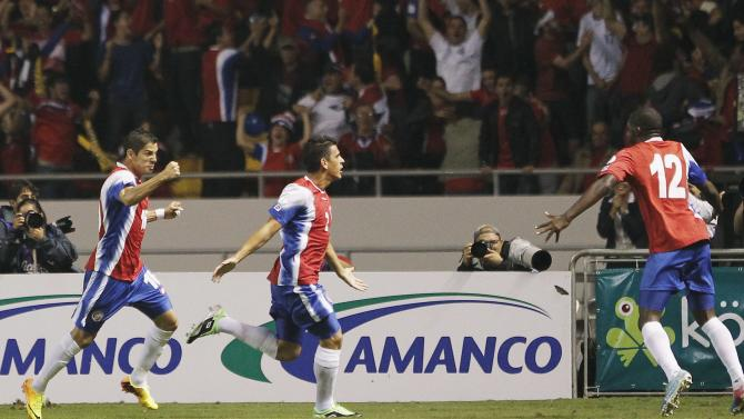 Costa Rica's Acosta celebrates his goal next to teammates Gamboa and Campbell during their 2014 World Cup qualifying soccer match against the U.S. in San Jose