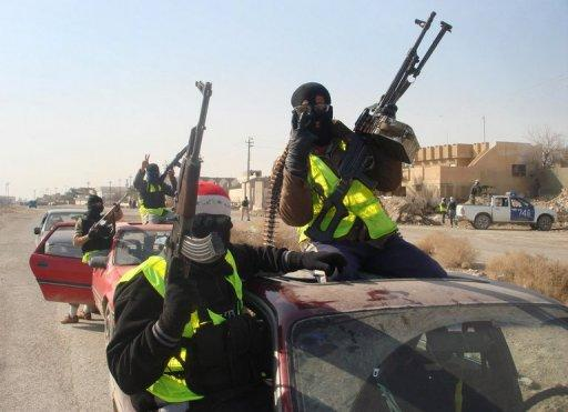 """Armed Sahwa or """"Awakening"""" militiamen patrol the northern Iraqi city of Samarra, on August 21, 2010. Iraqi officials say they will raise the salaries of Sunni militiamen who fought Al-Qaeda during the country's brutal sectarian war, the latest bid to appease mostly-Sunni anti-government rallies"""