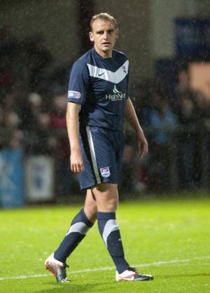 Grant Munro says Ross County should look to emulate Saturday's opponents St Johnstone