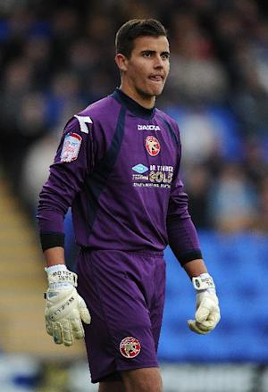Karl Darlow will stay at Walsall for another two months