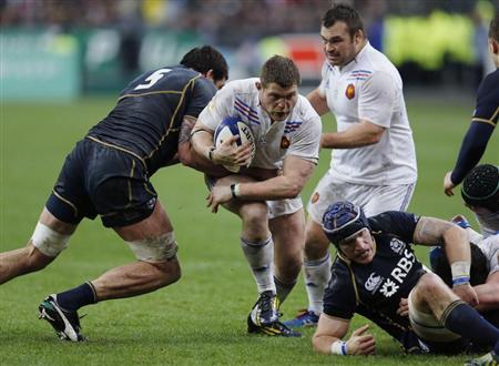 France's Kayser fights for the ball with Scotland's Hamilton and Scotland's Gilchrist during their Six Nations rugby union match at the Stade de France in Saint-Denis