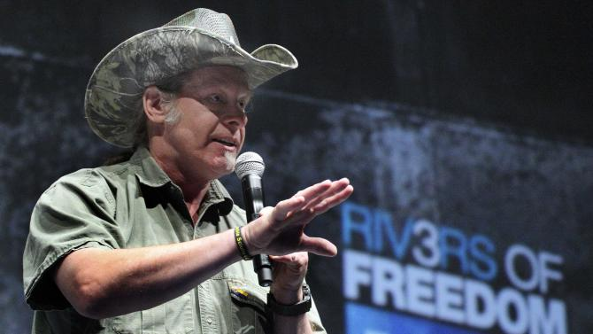 FILE - In this May 1, 2011 file photo, rocker and gun rights advocate Ted Nugent addresses a seminar at the National Rifle Association's 140th convention in Pittsburgh. Nugent was expected to plead guilty Tuesday, April 24, 2012 to transporting a black bear he illegally killed in Alaska  (AP Photo/Gene J. Puskar, File)