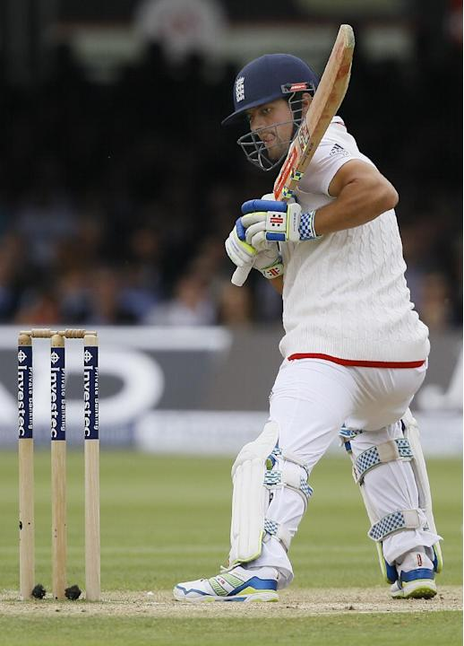 England's Alastair Cook watches the ball after he plays a shot off the bowling of New Zealand's Mark Craig during the fourth day of the first Test match between England and New Zealand at Lord