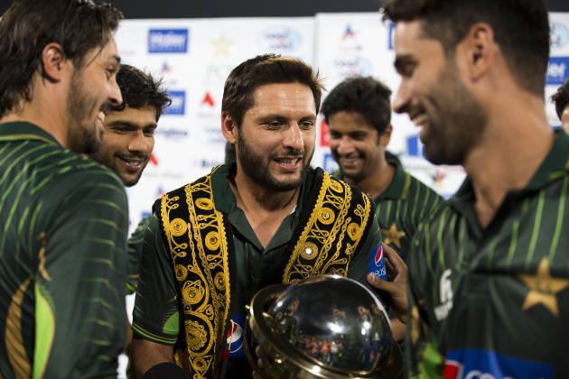 Shahid Afridi, center, captain of the Pakistani cricket team, celebrates the victory with players against Zimbabwe at the Gaddafi Stadium in Lahore, Pakistan, Sunday, May 24, 2015. The Twenty20 matche