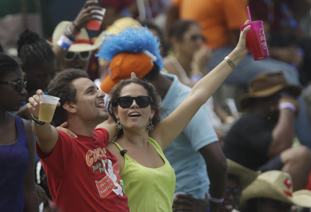 Fans cheer during a one-day international cricket match between England and West Indies at the Sir Vivian Richards Cricket Ground in St. John's, Antigua, Friday, Feb. 28, 2014. (AP Photo/Ricardo M