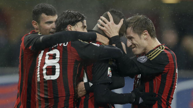 AC Milan forward Mario Balotelli, second from right, celebrates after scoring with his teammate midfielder Riccardo Montolivo, center, AC Milan forward Andrea Petagna, left, and AC Milan Valter Birsa of Slovenia, during a Serie A soccer match between AC Milan and Hellas verona, at the San Siro stadium in Milan, Italy, Sunday, Jan. 19, 2014